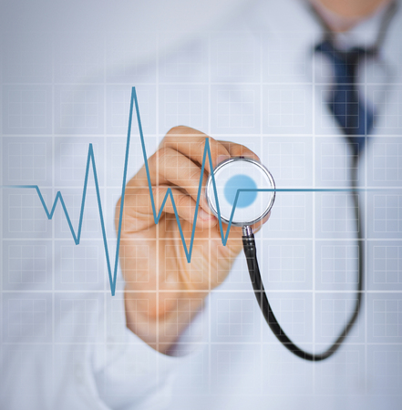 47564120 - picture of doctor hand with stethoscope listening heart beat